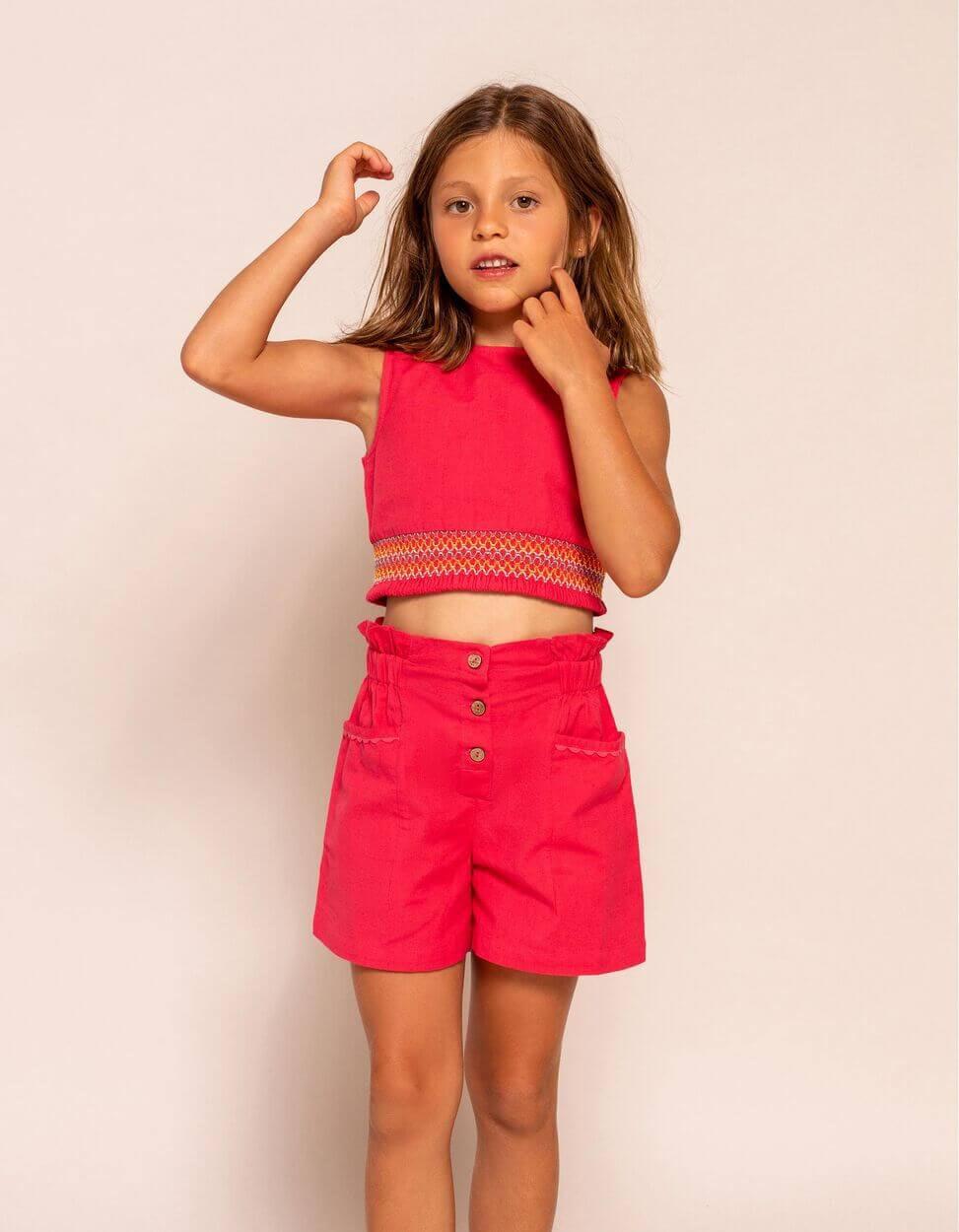 menina com top e calções cor de rosa da zippy